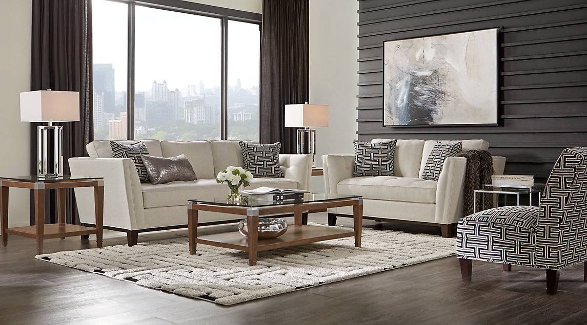 Cindy Crawford Living Room Set Beige Couch With Black And White Accent Pillows On A Rug