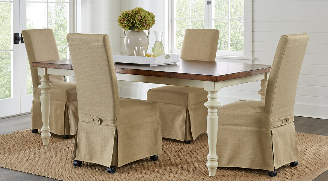 picture of the Hillside Cottage dining room set with beige covered chairs