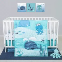 Picture of a blue nautical themed crib bedding set with whales, octopuses, and anchors..