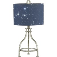 Picture of a silver based kids table lamp with a dark blue shade with constellations printed on it.