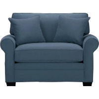 Picture of a blue living room chair with matching pillows