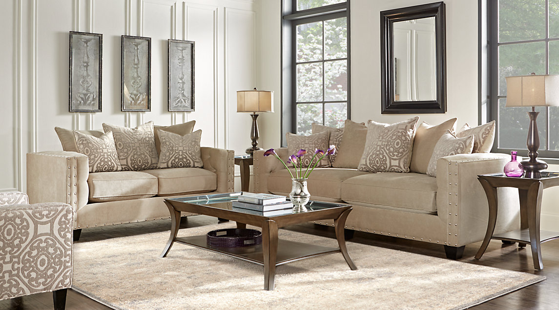 Cindy Crawford Living Room Set Biege Couch With White Accent Pillows Black Lamps On End Tables And A